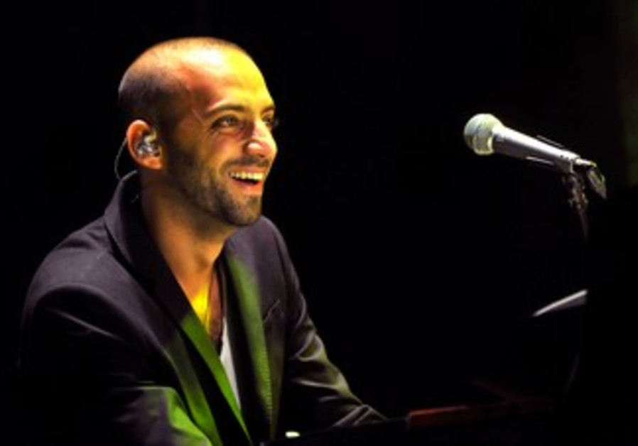 Idan Raichel performing at Ceaserea Amphitheater
