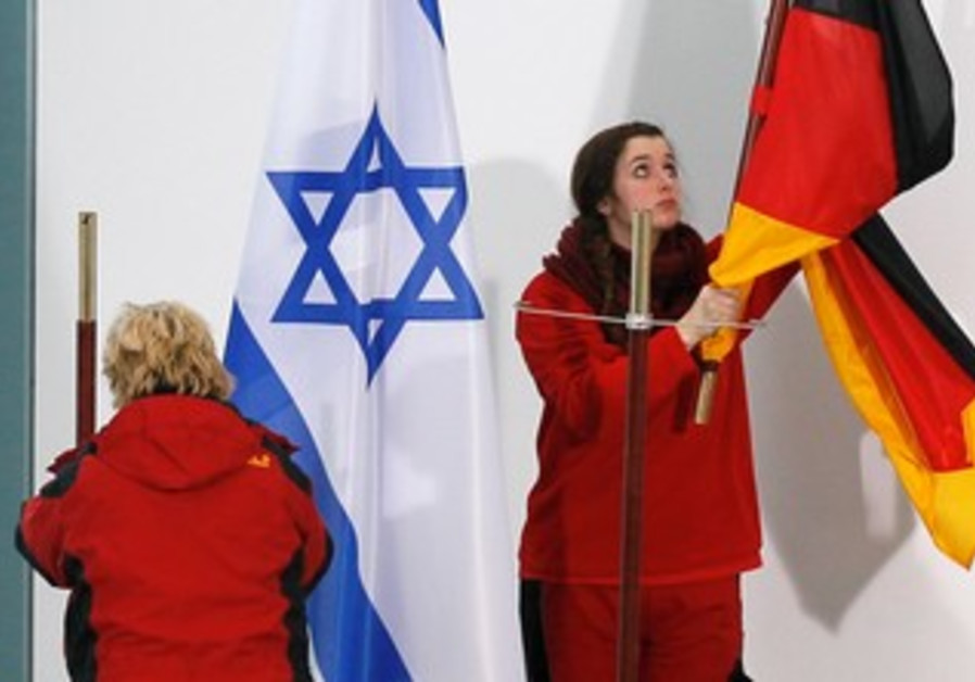 A WOMAN removes a German flag