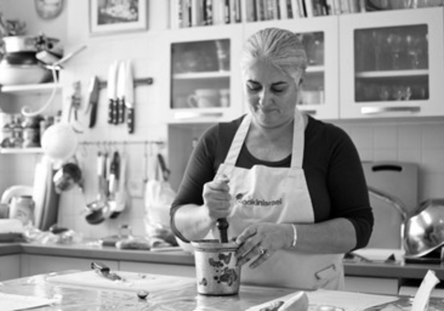 Orly Ziv cooking at home