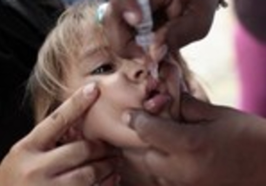 A child receives polio vaccination drops in Managua April 15, 2013.