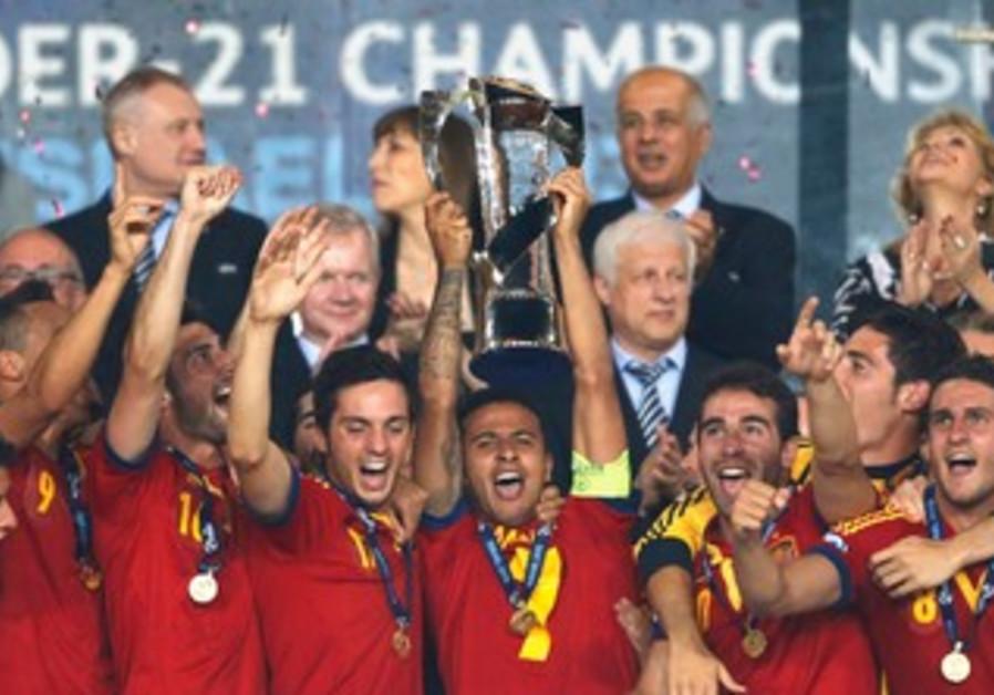 Spain celebrates its championship of UEFA Under-21 tournament.