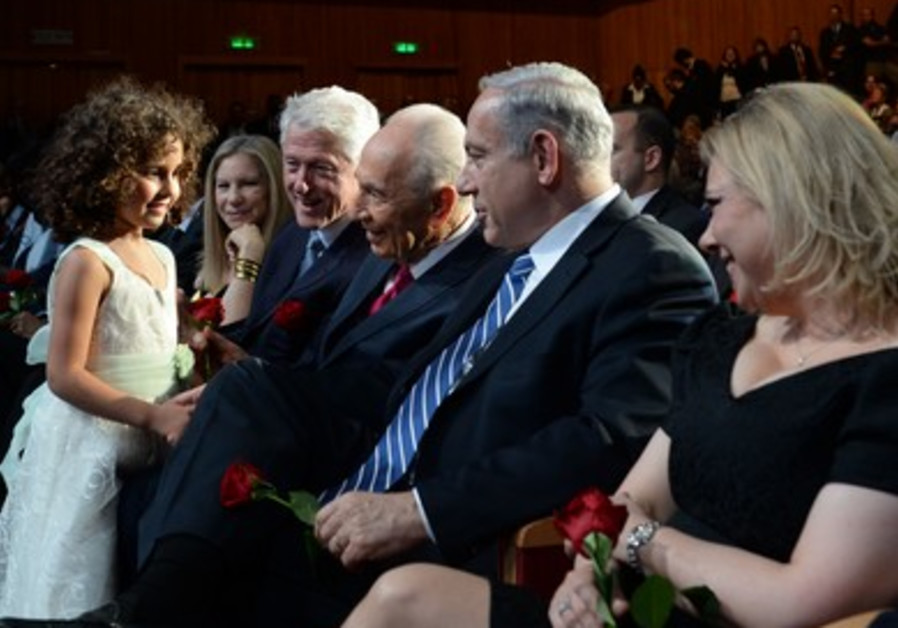 Shimon Peres receives a birthday rose at the 2013 President's Conference.