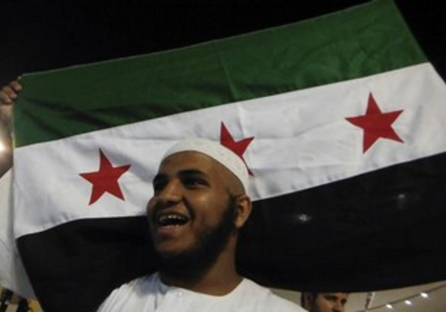 Syrian Muslim pilgrim shouts slogans against Assad in Mina, near the holy city of Mecca October 27.