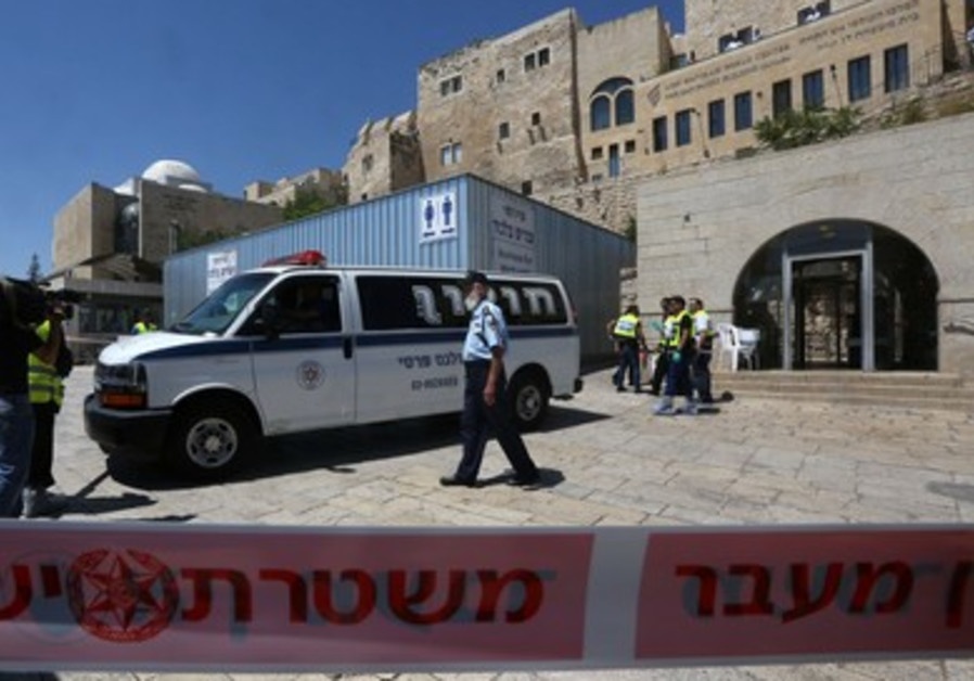 Security forces block off the vicinity of a shooting at the Western Wall complex June 21, 2013.