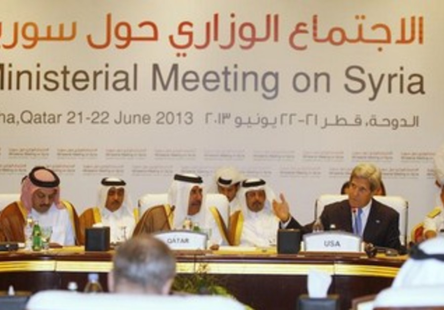 """US Secretary of State John Kerry (R) at the London 11 countries """"Friends of Syria"""" meeting in Doha."""