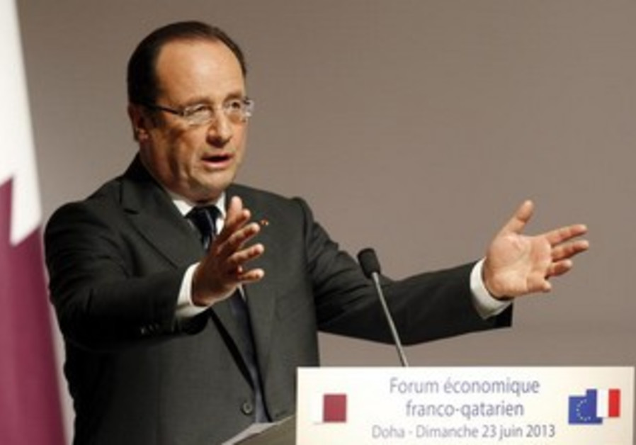 Hollande speaks during the opening of the Qatari-French Business Forum in Doha June 23, 2013.