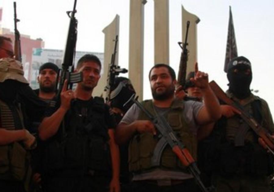 Sunni Muslim gunmen express solidarity with al-Assir in Tripoli, June 23, 2013.
