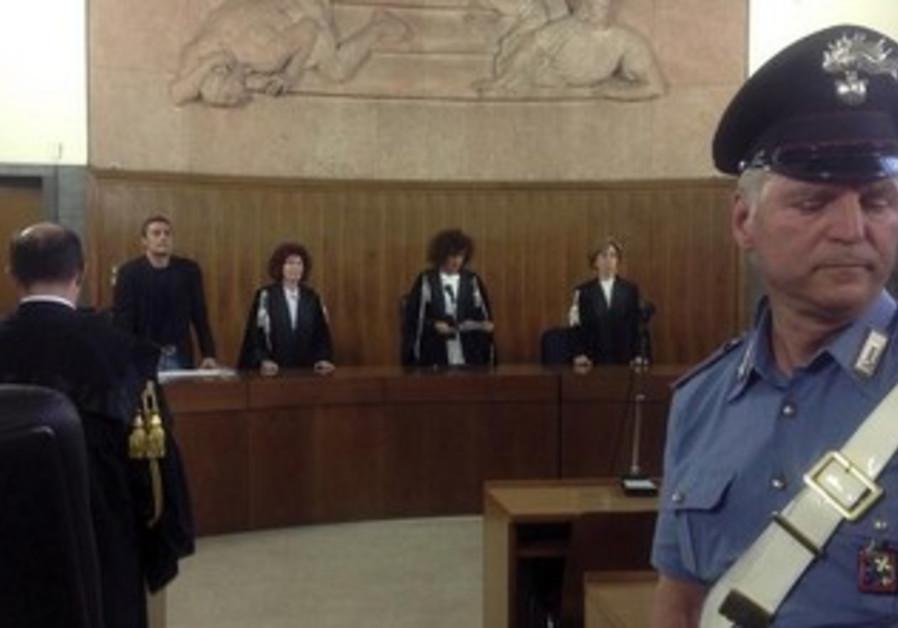 Giulia Turri (C) reads the sentence for former Italian prime minister Silvio Berlusconi in Milan.