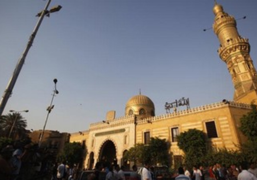 Egyptians stand outside El Sayeda Nafisa Mosque after funeral prayers for Shi'ite victims, June 24.
