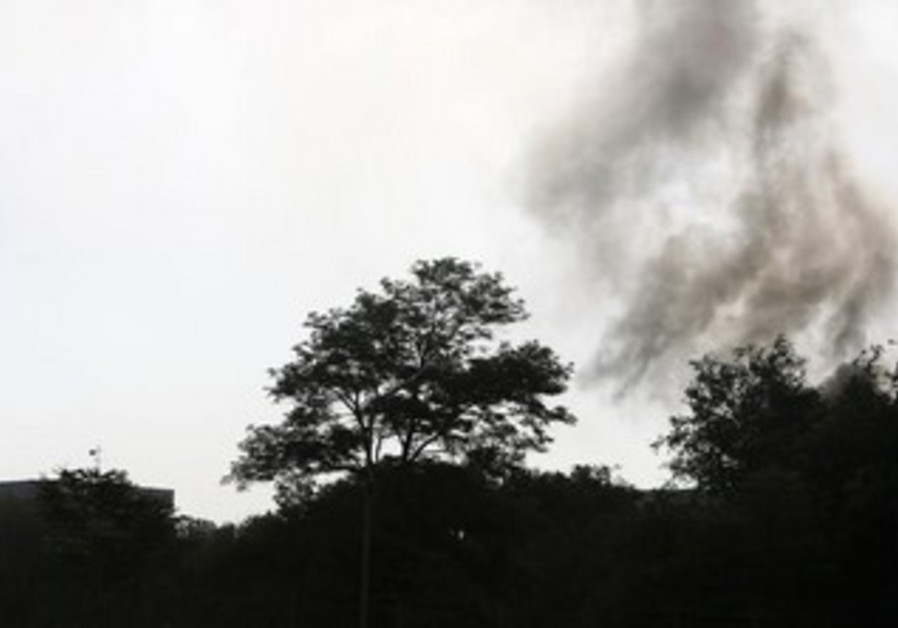 Smoke rises from the site of an attack in Kabul June 25, 2013.