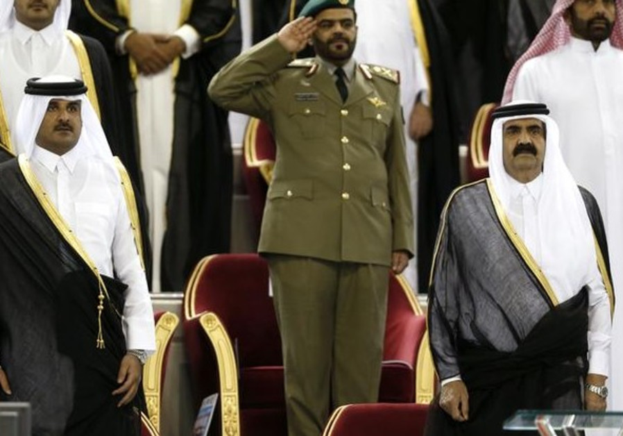 Qatar's Emir Sheikh Hamad bin Khalifa al-Thani (R) stands next to his son Crown Prince Sheikh Tamim