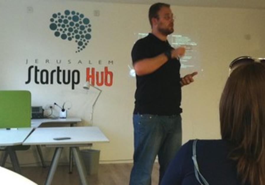 KFIR DAMARI, scientist and hi-tech guru, speaks at the downtown Jerusalem Startup Hub about Space IL