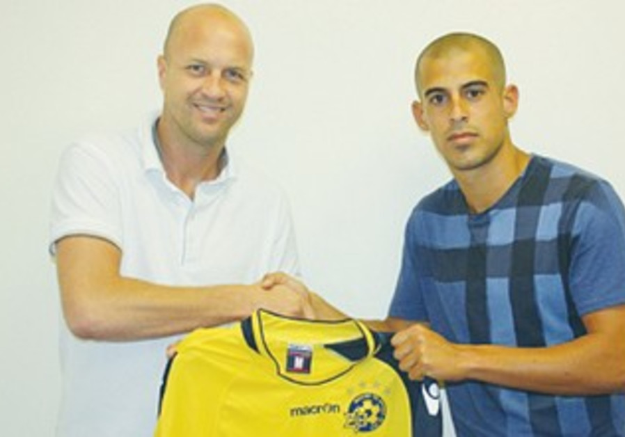 ISRAELI STRIKER Tal Ben-Haim (right) completed a shock move from Hapoel TA to arch-rival Maccabi TA