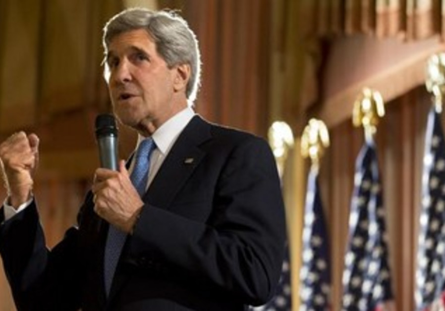 U.S. Secretary of State John Kerry speaks to staff from the US Embassy in Kuwait City.