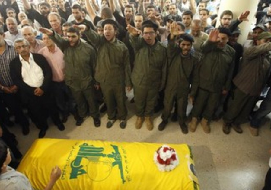 Supporters of Hezbollah and relatives gesture during a funeral.