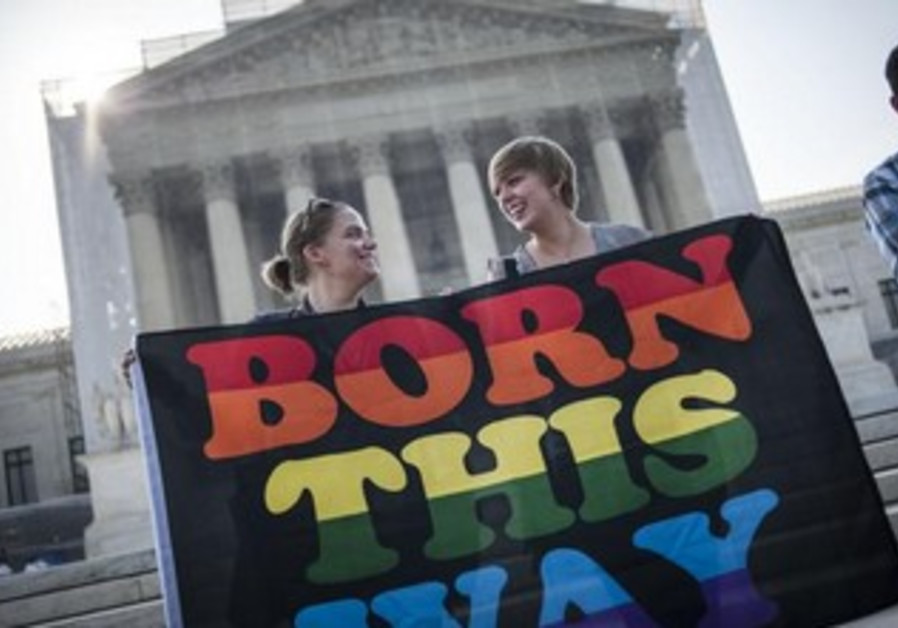 Demonstrators await decisions in two cases regarding same-sex marriage at the U.S. Supreme Court .