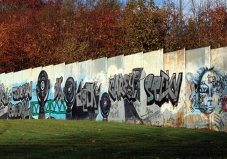 'Peace Wall' in Ireland separating Catholics and Protestants.