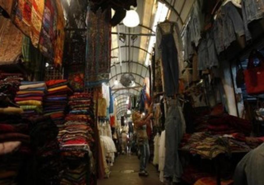 A woman shops at the flea market in Jaffa, just south of Tel Aviv June 3, 2009.