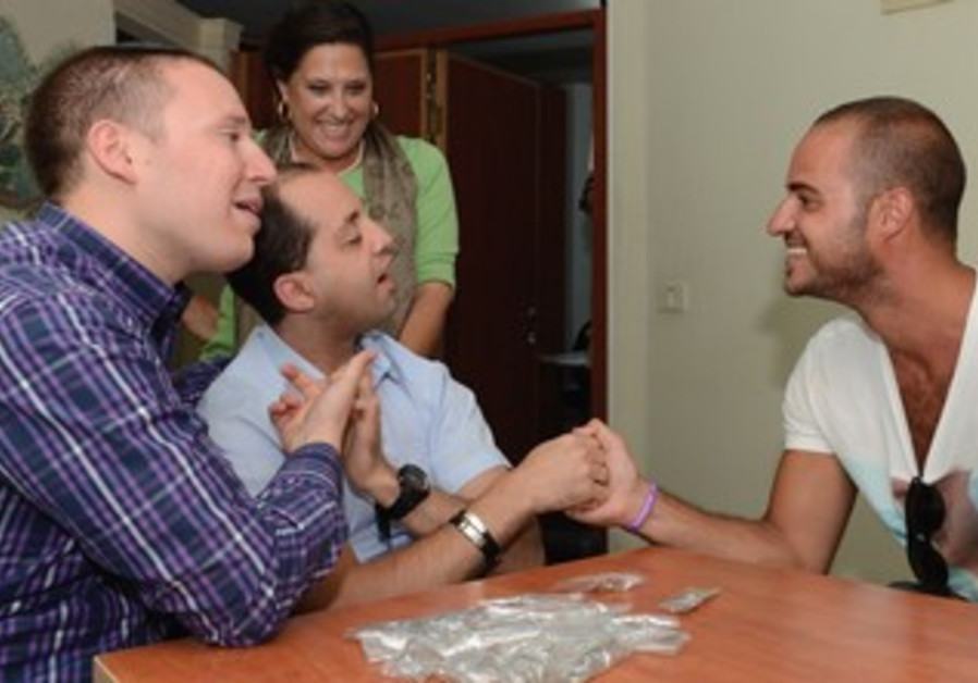 'HAMEROTZ LAMILLION' contestant Eliran Look (right) communicates with deaf and blind  Yossi Samuels