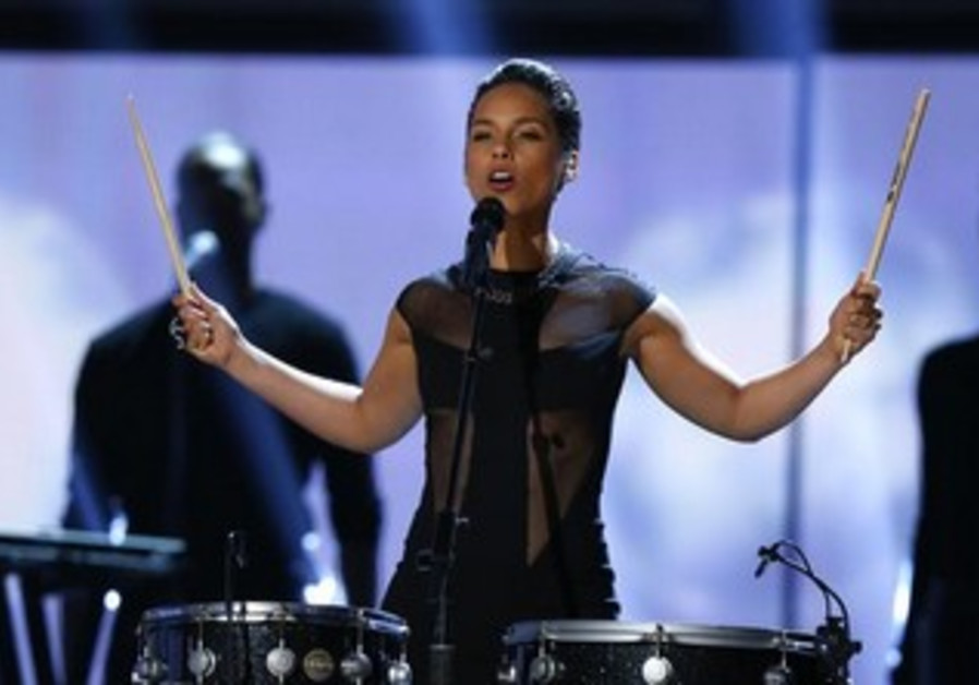 Singer Alicia Keys performs at the Grammy Awards in Los Angeles, February 10, 2013.