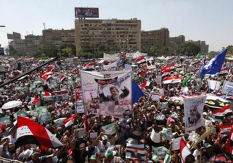 Morsi supporters protest around the Raba El-Adwyia mosque square in Cairo, June 28, 2013.
