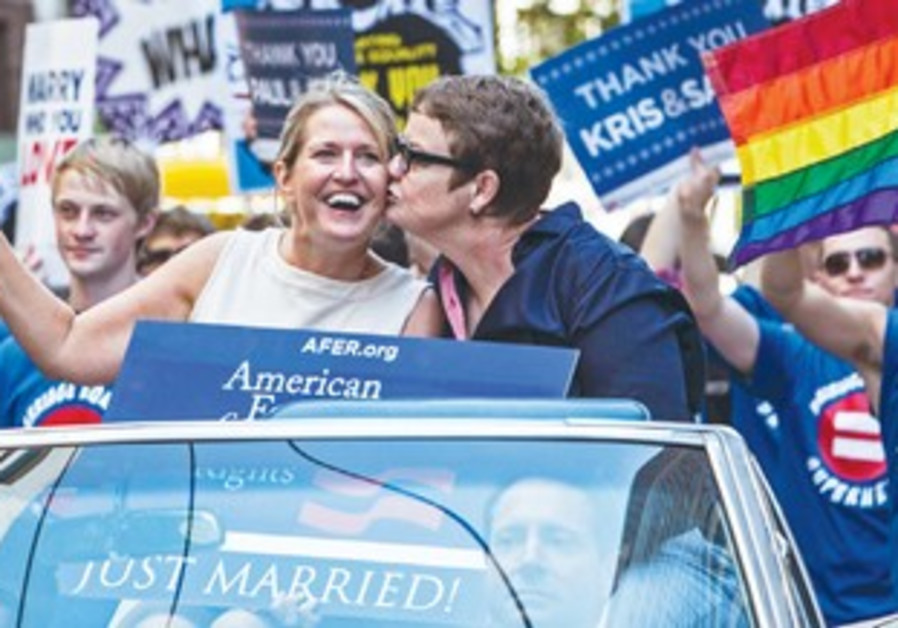 KRIS PERRY kisses her wife Sandy Stier during the San Francisco Pride Parade.