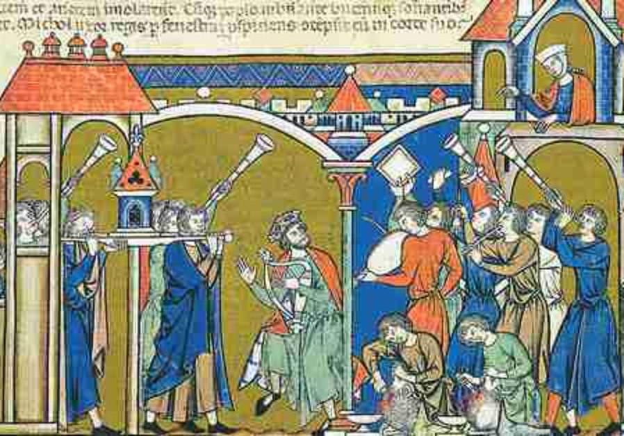 David dances in the presence of the ark