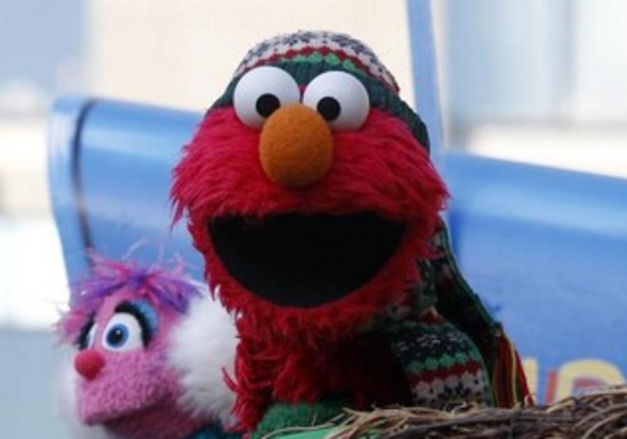 An Elmo muppet.