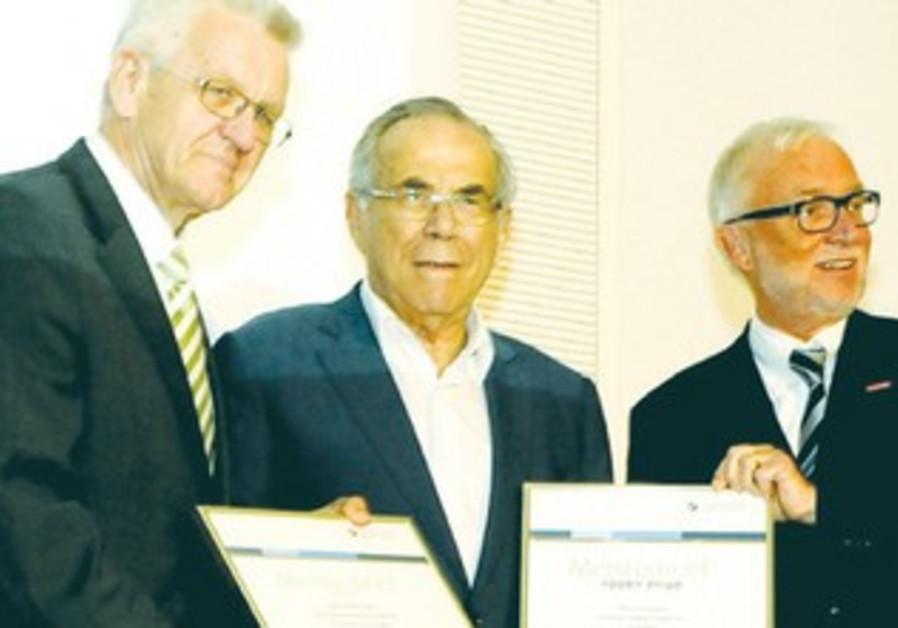 Winfried Kretschmann, Stef Wertheimer and Claus Munkwitz at the ceremony awarding Meister diplomas.
