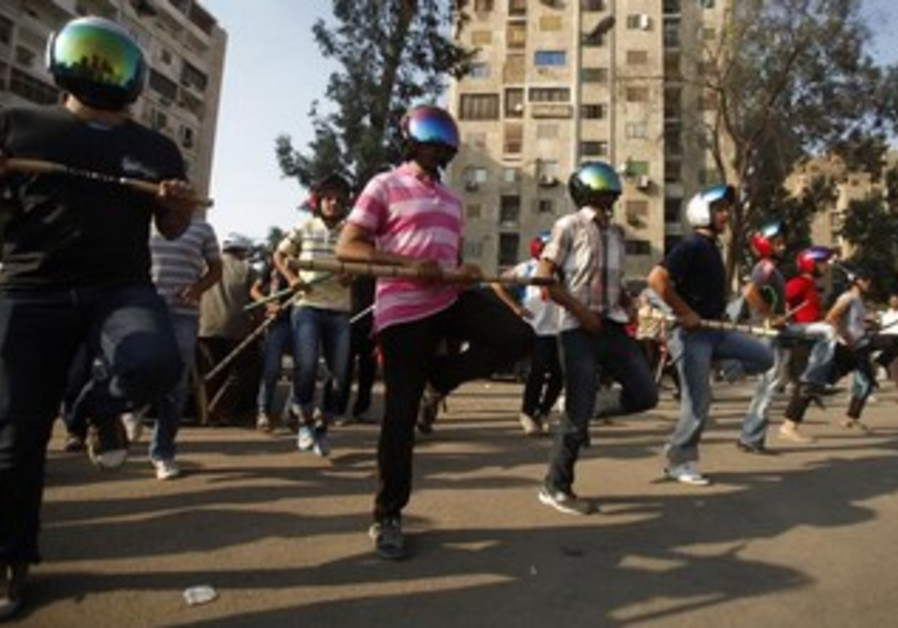 Mohamed Morsi supporters perform drill in Cairo
