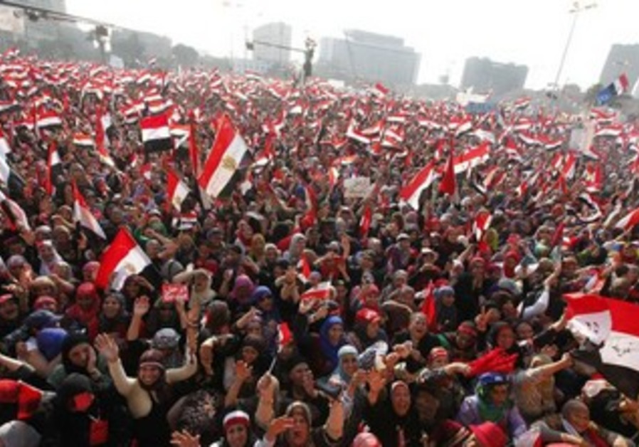 Protesters against Egyptian President Mohamed Morsi wave national flags