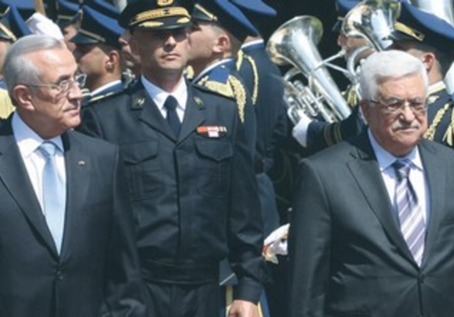 PA PRESIDENT Mahmoud Abbas (r) walks past an honor guard with Lebanese President Michel Suleiman.