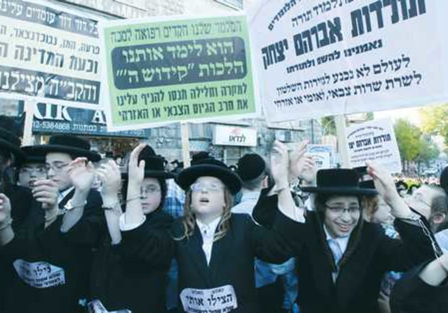 HAREDI YOUTH participate in a protest against the draft