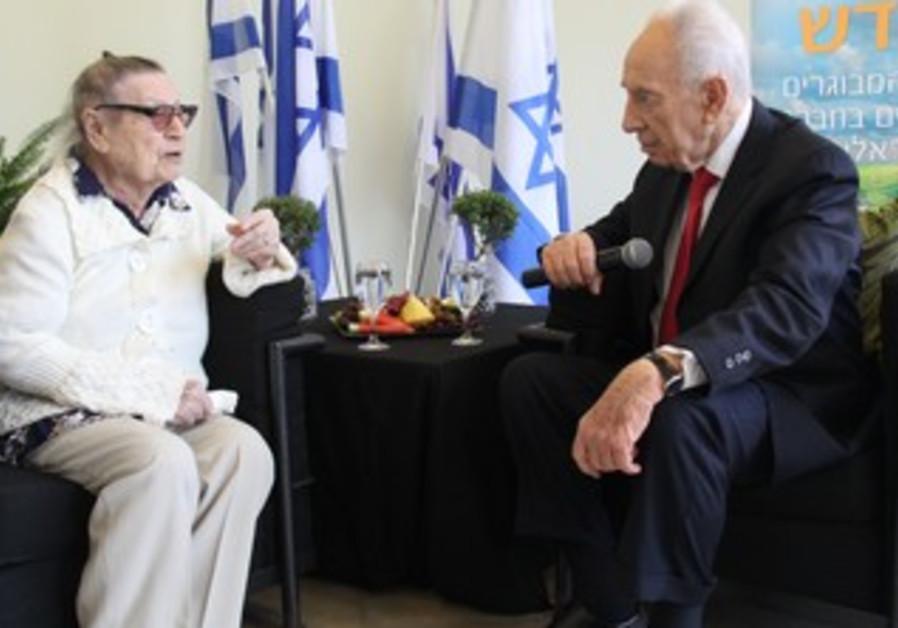 Shimon Peres with holocaust survivor Mira Shoval.