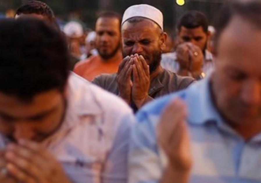A supporter of former Egyptian President Mohamed Morsi performs prayers near Cairo University.