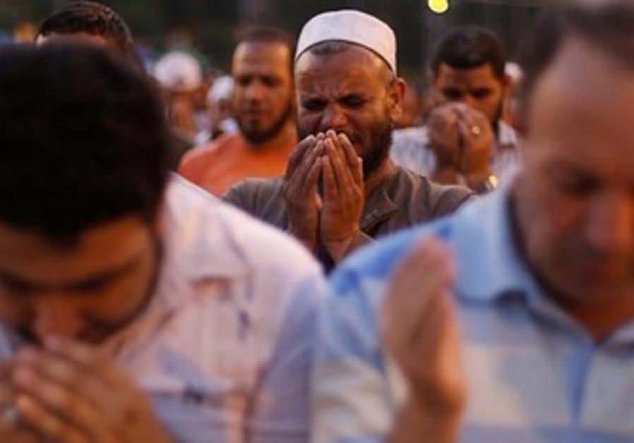 A supporter of former Egyptian President Mohamed Morsi performs prayers near Cairo University.