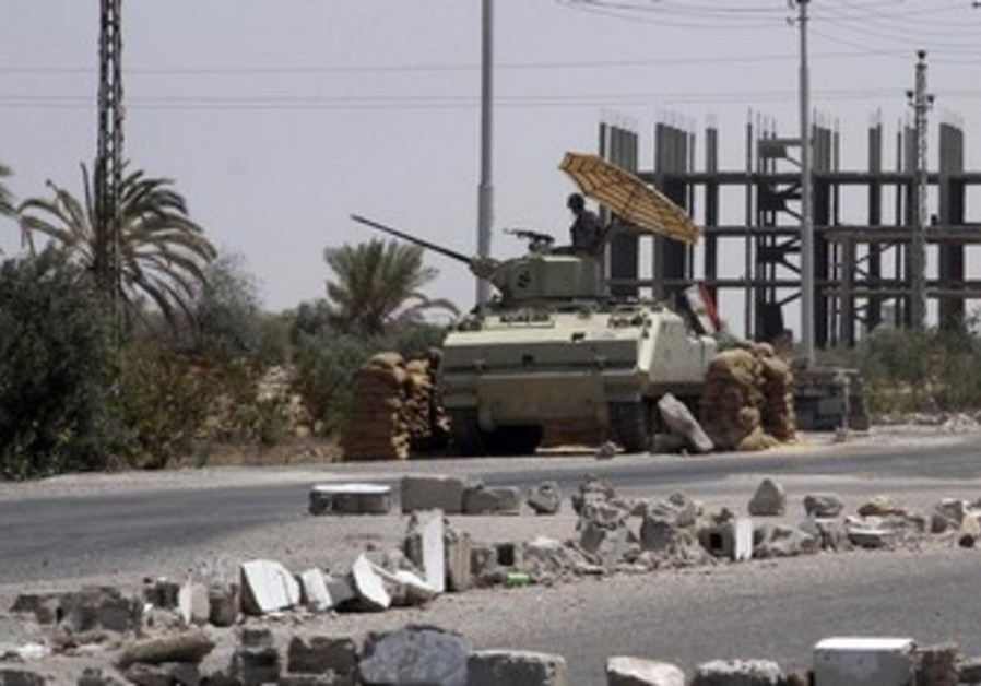 Egyptian soldier guards checkpoint in Rafah in Sinai