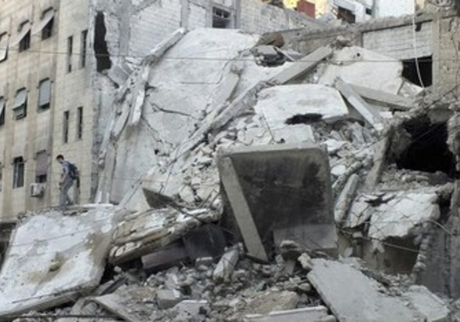 Rubble of buildings damaged by shelling by Assad's forces in besieged area of Homs July 4, 2013.