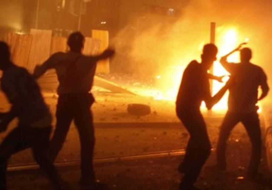 Anti-Morsi protesters demonstrate near pro-Morsi supporters, near Tahrir Square in Cairo July 5