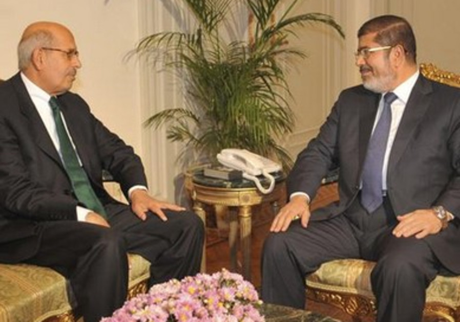 Mohamed Elbaradei (L) and deposed president Mohamed Morsi in Novermber, 2012.