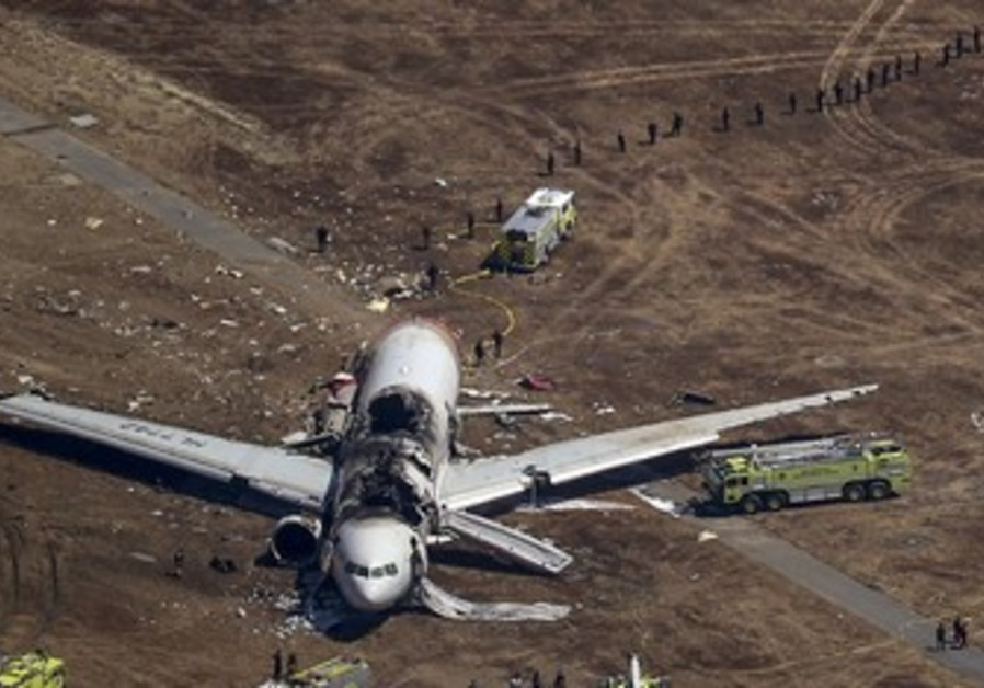 Search and rescue officials surround an Asiana Airlines plane after it crashed in San Francisco