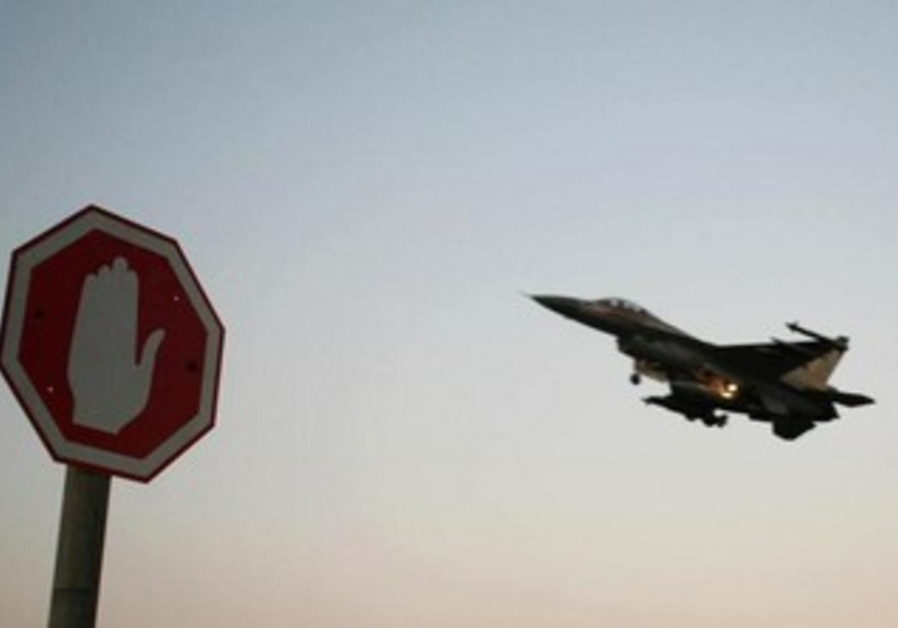 An Israeli Air Force F-16 fighter plane flying above a traffic sign from an Israeli Air Force Base.