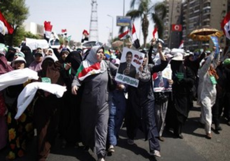 Supporters of deposed Egyptian President Mohamed Mursi march in Cario, July 7, 2013.