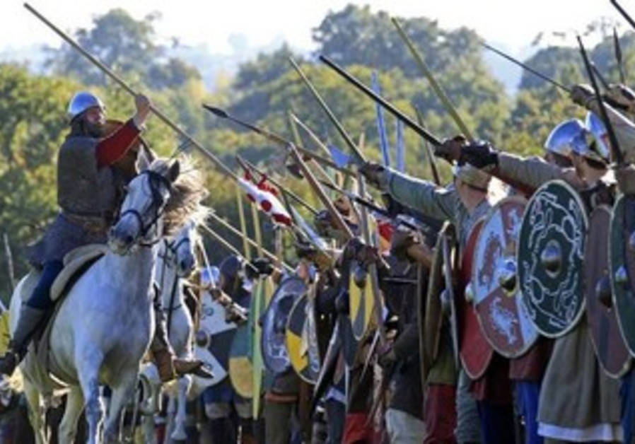 MEN REENACT the decisive 1066 Battle of Hastings in England.