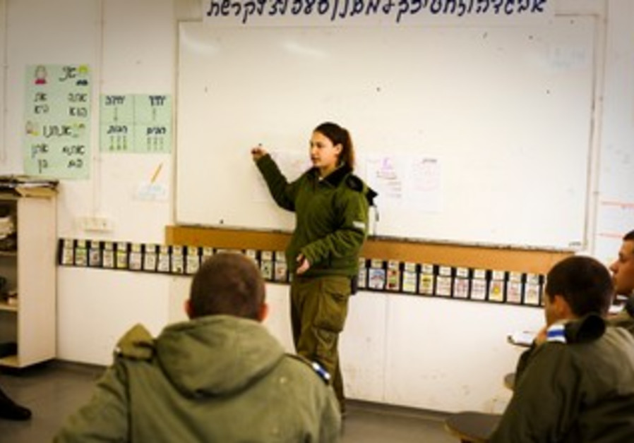 Photos of Dafna Barchad teaching soldiers for their matriculation exams.