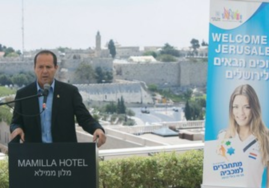 Jerusalem Mayor Nir Barkat at a press conference to promote the 19th quadrennial Maccabiah Games.