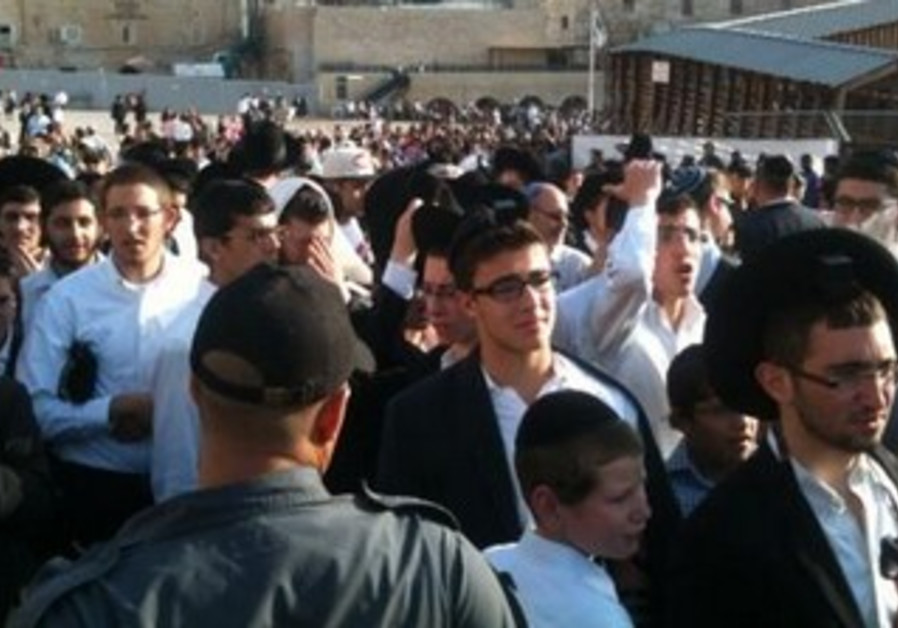 Haredim protest Women of the Wall's prayer service at the Kotel, July 8, 2013.