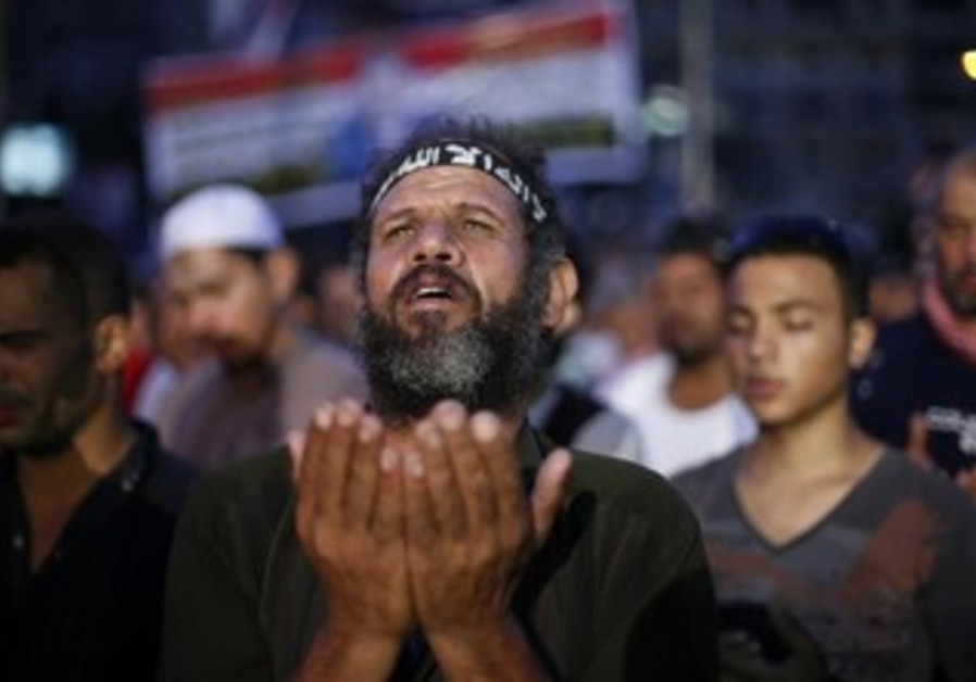 A supporter of deposed Egyptian President Mohamed Morsi attends night prayers