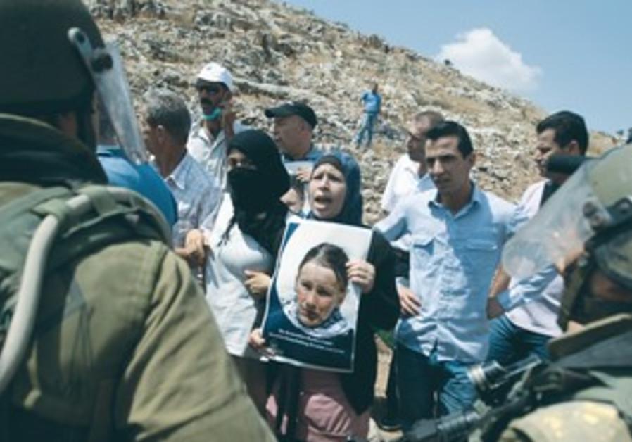 PALESTINIAN PROTESTER Nariman Tamimi (center) during weekly demonstration in Nabi Salih