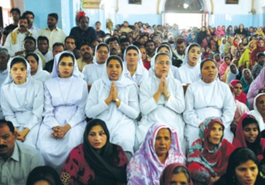 PAKISTANI CHRISTIANS pray at a church in Lahore.